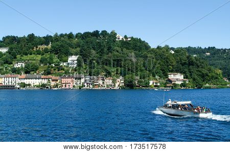 People On A Boat Front Of Orta
