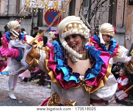 AALST, BELGIUM, FEBRUARY 26 2017: Unknown female dancer enjoying the parade during the annual carnival  in Aalst, which is a UNESCO recognized event of Intangible Cultural Heritage.