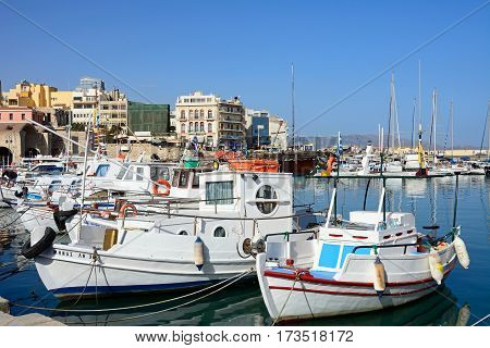 HERAKLION, CRETE - SEPTEMBER 19, 2016 - Yachts and boats moored in the harbour with waterfront buildings to the rear Heraklion Crete Greece Europe, September 19, 2016.
