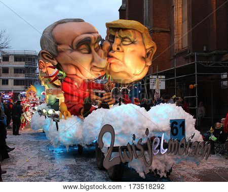 AALST, BELGIUM, FEBRUARY 26 2017: Caricature of Donald Trump on one of the brightly lit floats during the carnival parade in Aalst, which is a UNESCO recognized event of Intangible Cultural Heritage.
