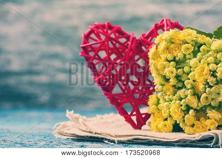 Kalanchoe Flowering Yellow Bouquet And Red Heart On A Wooden Bac