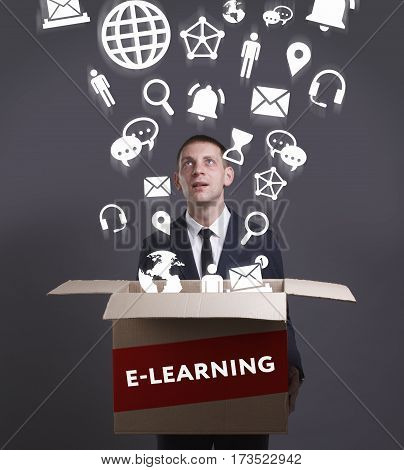 Business, Technology, Internet And Network Concept. Young Businessman Shows The Word: E-learning