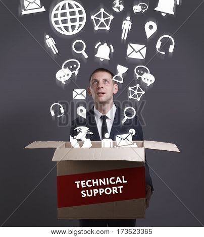 Business, Technology, Internet And Network Concept. Young Businessman Shows The Word: Technical Supp