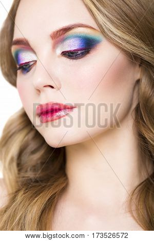 Close up portrait of a beautiful young blond model with bright make up
