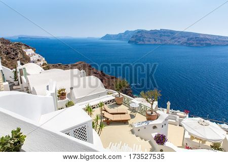 SANTORINI ISLAND, CRETE, GREECE, - June 29, 2013: View of Fira town. White concrete staircases leading down to beautiful bay with clear blue sky and sea in Santorini island