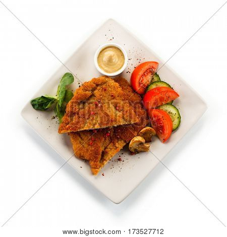 Fried pork chop and vegetables