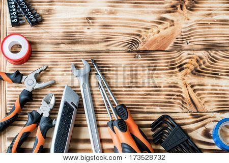 A set of tools on a wooden background.