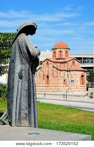 Mana nun statue along Leof Plastira with a modern Greek church to the rear Heraklion Crete Greece Europe.