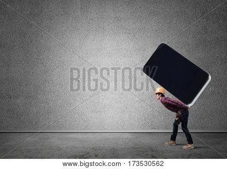 Man engineer carrying on back big smartphone