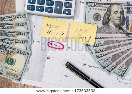 15 April, Tax Day On Calendar With Red Marker Pen With Dollar Banknote, Pen And Calculator.
