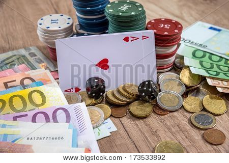 Cards And Chips For Poker, Euro Bills And Coin On Desk.