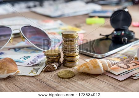 Travel Concept - Euro Bills, Compass, Seashell, Phone.
