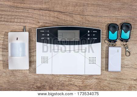 alarm system home on wooden desk .
