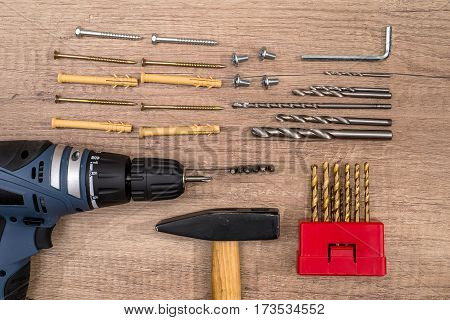 Variety of tools of builder on wooden texture table