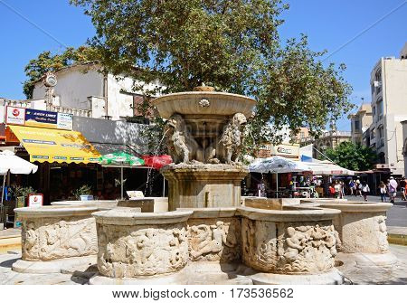 HERAKLION, CRETE - SEPTEMBER 19, 2016 - View of the Morosini fountain in Lions Square in the city centre Heraklion Crete Greece Europe, September 19, 2016.