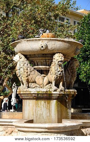 HERAKLION, CRETE - SEPTEMBER 19, 2016 - View of the Morosini fountain in Lions Square in the city centre Heraklion Crete Greece Europe, September 19. 2016.