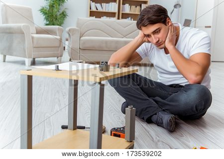 Man assembling furniture at home