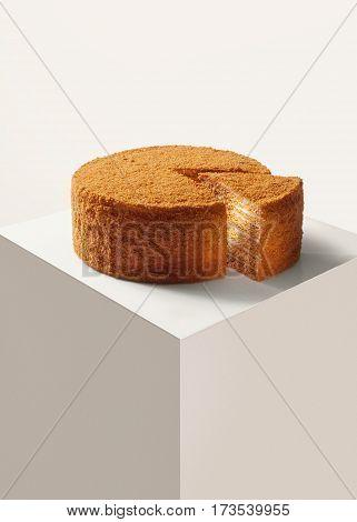 view of nice fresh  honey cake on white back