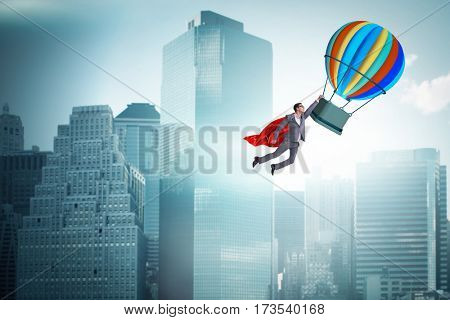 Businessman flying on balloon in challenge concept