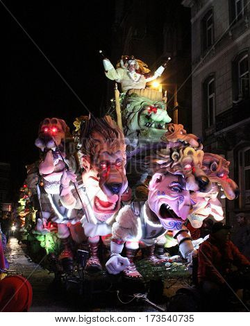 AALST, BELGIUM, FEBRUARY 26 2017: One of the brightly lit floats during the annual carnival parade in Aalst, which is a UNESCO recognized event of Intangible Cultural Heritage.