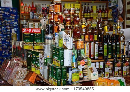 HERAKLION, CRETE - SEPTEMBER 19, 2016 - Olive oil for sale at a city centre shop along Odos 1821 Heraklion Crete Greece Europe, September 19, 2016.