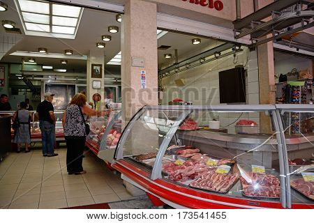 HERAKLION, CRETE - SEPTEMBER 19, 2016 - Customers in a butchers shop at a city centre shop along Odos 1821 Heraklion Crete Greece Europe, September 19, 2016.