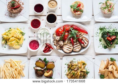 Vegetable snacks with sauces flat lay. Top view on vegetarian buffet, healthy and organic food. Vegan party, seasoning, fasting, summer, buffet, health care, diet concept