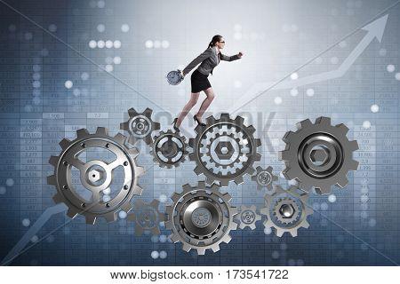Woman businesswoman walking in cogwheels