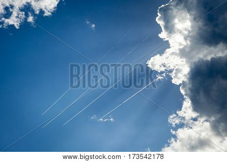 Planes flying across the sky leaving a trail