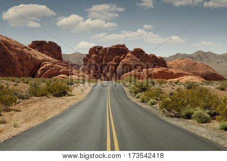 panoramic view of hot summer road through the Fire Valley State Park in Utah