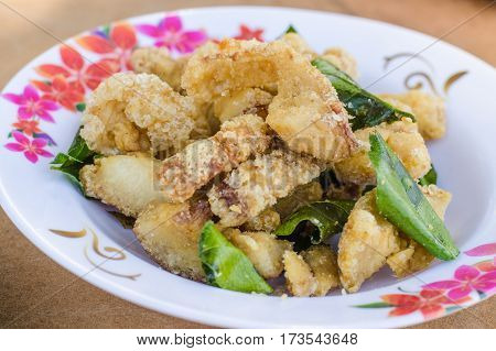 Pork rind on a white plate , cook, cooked, crackling,
