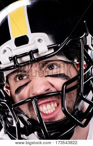 Close-up view of angry man american football player in helmet looking away