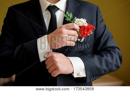groom in the wedding morning clothes cuffs on shirt.