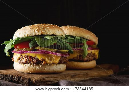 Fast Food. Vegetarian Burger With A Chop, Cucumber, Tomato And L