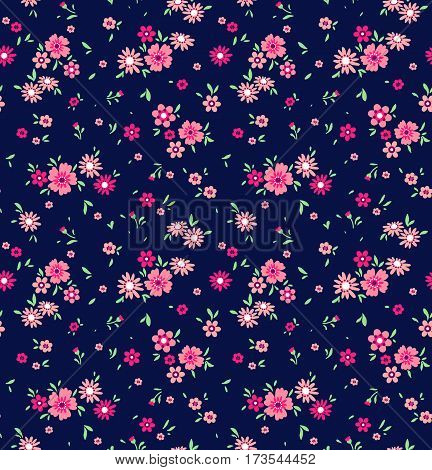 Floral pattern. Pretty flowers on dark blue backgroung. Printing with Small-scale pink flowers. Ditsy print. Seamless vector texture. Spring bouquet.