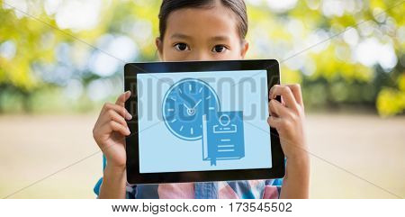 Print against girl holding digital tablet while standing
