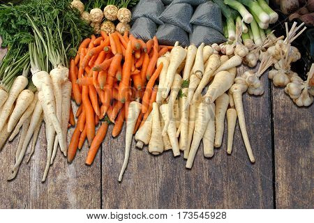 Various organic market vegetables on the wooden desk