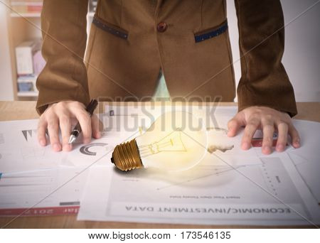 Business worker with light bulb on desk office. concept of new ideas with innovation and creativity.