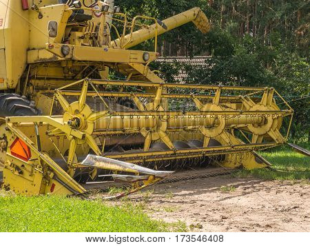 Wolka Zamkowa Poland - August 13 2016: Big Yellow harvester threshing grain in a field