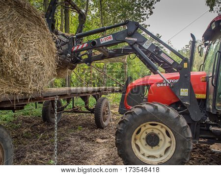 Tractor And Big Bales Of Straw