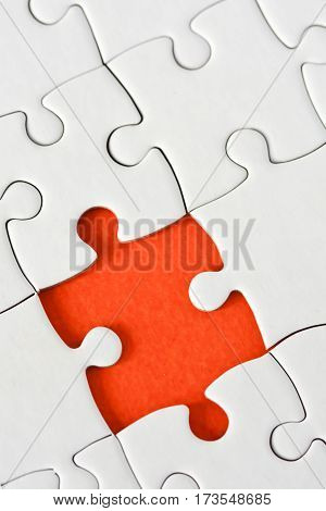Incomplete jigsaw puzzle game with one missing puzzle piece