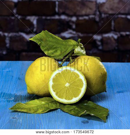 Acid and yellow fruit. Lemons on a blue wood stock photo
