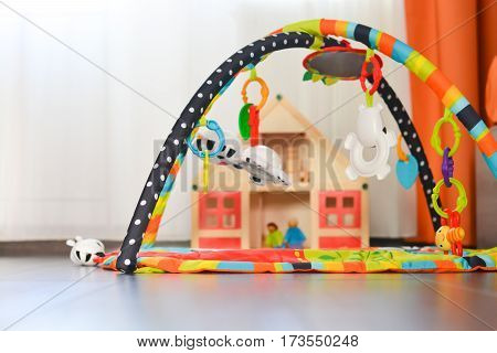 Newborn playground or activity center with a colorful tent