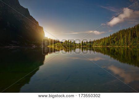 Sunrise over a mountain lake. Popradske pleso