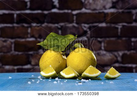 Acid and yellow fruit. Lemons on a blue wood stock photo