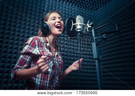 Singing woman in a recording studio