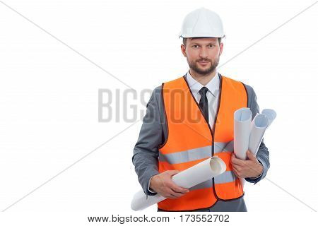 Working on future. Handsome mature businessman engineer holding building plan blueprints posing on white background wearing hardhat and orange safety vest copyspace on the side