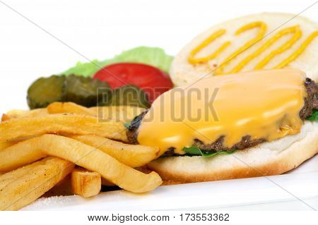 open cheeseburger burger closeup with french fries