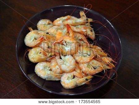 Cooked shrimp in a bowl on a table