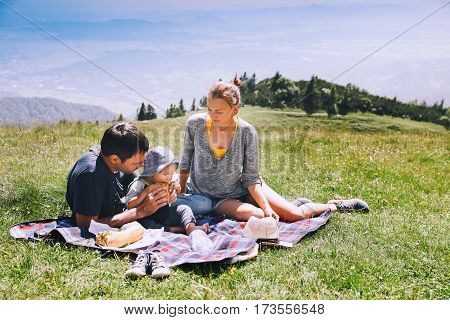 Family Spend Time On Nature In The Mountains.